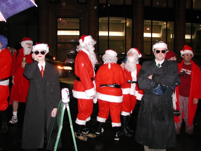 Agents endure heavy rain during the first deployment of Service agents to Santacon